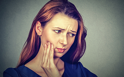 Woman with dry socket tooth pain